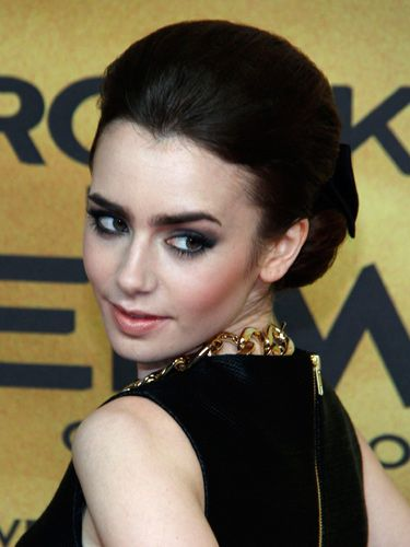 "<p>Looking like a modern-day Audrey Hepburn, Lily Collins takes on the trend with big silver screen hair and seriously smokey eye makeup. And totally pulls it off, naturally.  </p> <p><a href=""http://www.cosmopolitan.co.uk/beauty-hair/news/styles/celebrity/cosmo-hairstyle-of-the-day"" target=""_blank"">COSMO'S HAIRSTYLE OF THE DAY</a></p> <p><a href=""http://www.cosmopolitan.co.uk/beauty-hair/news/styles/celebrity/frow-hair-celebrity-fashion-week"" target=""_blank"">FRONT ROW HAIRSTYLES WE LOVE</a></p> <p><a href=""http://www.cosmopolitan.co.uk/beauty-hair/news/styles/celebrity/"" target=""_blank"">MORE CELEBRITY HAIR IDEAS</a></p>"