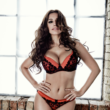 """<p>Black, red and HAWT all over. Here, Kelly does the hands in front of hips pose, accentuating that weeny waist *sigh*<em><br /></em></p><p><em>Shop Kelly Brook's lingerie collection for New Look at <a href=""""http://www.newlook.com/shop/result?Ntt=Kelly+Brook+Lingerie&filtered=1"""" target=""""_blank"""">newlook.com</a> now. Prices start at £6.</em></p><p><a href=""""http://www.cosmopolitan.co.uk/fashion/shopping/kelly-brook-new-look-aw13"""" target=""""_blank"""">SEE KELLY BROOK'S WINTER FASHION RANGE </a></p><p><a href=""""http://www.cosmopolitan.co.uk/fashion/news/lingerie-show-2013"""" target=""""_blank"""">WATCH THE ACTION FROM COSMO'S LINGERIE SHOW</a></p><p><a href=""""http://www.cosmopolitan.co.uk/fashion/shopping/the-fashion-fix-shop-bargain-buys"""" target=""""_blank"""">SHOP: FASHION BUYS FOR £10 OR LESS</a></p>"""