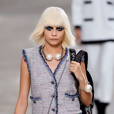 """<p>Cara was representing the wig trend during Fashion Month, from Marc Jacobs to Fendi. We love this pretty-meets-punk wig that she rocked at the Chanel show in Paris earlier this month.</p><p><a href=""""http://www.cosmopolitan.co.uk/beauty-hair/news/styles/celebrity/cosmo-hairstyle-of-the-day"""" target=""""_blank"""">HAIRSTYLE OF THE DAY</a></p><p><a href=""""http://www.cosmopolitan.co.uk/beauty-hair/news/hairstyles/wig-hair-trend-2013-14"""" target=""""_blank"""">WHY WIGS ARE THE NEW HAIR TREND</a></p><p><a href=""""http://www.cosmopolitan.co.uk/beauty-hair/news/trends/celebrity-beauty/georgia-may-jagger-instagram-cara-delevingne"""" target=""""_blank"""">THE NEW WIG TREND AT FASHION WEEK</a></p>"""