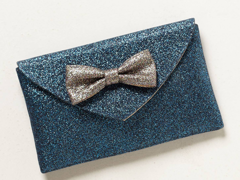 """<p>We're preparing to party in style and this adorbs glitter clutch bag will glam up any going-out look. We might even go crazy and take it to the office.</p> <p>Bowtie shimmer clutch, £18, <a href=""""http://www.anthropologie.eu/anthro/product/newarrivals-accessories/7154469304438.jsp"""" target=""""_blank"""">anthropologie.eu</a></p> <p><a href=""""http://www.cosmopolitan.co.uk/fashion/shopping/womens-clothing-under-ten-pounds"""" target=""""_blank"""">Shop daily fashion finds for £10 or less</a></p> <p><a href=""""http://www.cosmopolitan.co.uk/fashion/shopping/investment-winter-coats"""" target=""""_blank"""">10 winter coats worth investing in</a></p> <p><a href=""""http://www.cosmopolitan.co.uk/fashion/winter-fashion-trends-2013/"""" target=""""_blank"""">See the latest winter fashion trends 2013</a></p>"""