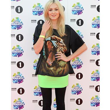 """<p>Always-stylish Fearne looked fierce in her tiger t-shirt and neon skirt, which she paired with black tights and heeled booties.</p><p><a href=""""http://www.cosmopolitan.co.uk/beauty-hair/news/trends/celebrity-beauty/celebrities-go-makeup-free"""" target=""""_blank"""">CELEBRITIES WITHOUT MAKEUP</a></p><p><a href=""""http://www.cosmopolitan.co.uk/beauty-hair/news/trends/celebrity-beauty/best-celebrity-beauty-tips"""" target=""""_blank"""">BEST CELEBRITY BEAUTY TIPS</a></p><p><a href=""""http://www.cosmopolitan.co.uk/beauty-hair/news/trends/celebrity-beauty/celebs-in-wigs"""" target=""""_blank"""">CELEBRITIES IN WIGS</a></p>"""