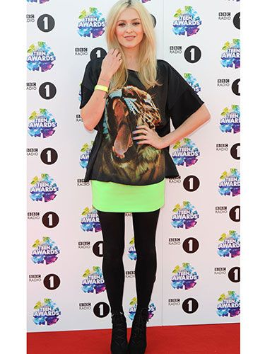"<p>Always-stylish Fearne looked fierce in her tiger t-shirt and neon skirt, which she paired with black tights and heeled booties.</p> <p><a href=""http://www.cosmopolitan.co.uk/beauty-hair/news/trends/celebrity-beauty/celebrities-go-makeup-free"" target=""_blank"">CELEBRITIES WITHOUT MAKEUP</a></p> <p><a href=""http://www.cosmopolitan.co.uk/beauty-hair/news/trends/celebrity-beauty/best-celebrity-beauty-tips"" target=""_blank"">BEST CELEBRITY BEAUTY TIPS</a></p> <p><a href=""http://www.cosmopolitan.co.uk/beauty-hair/news/trends/celebrity-beauty/celebs-in-wigs"" target=""_blank"">CELEBRITIES IN WIGS</a></p>"