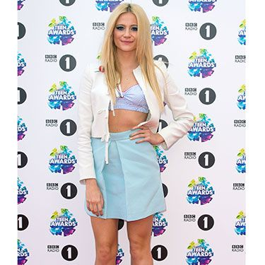 """<p>Pixie showed off her toned tum in a cropped top, blue skirt, and white leather jacket over top. Sweet, yet sexy.</p><p><a href=""""http://www.cosmopolitan.co.uk/beauty-hair/news/trends/celebrity-beauty/celebrities-go-makeup-free"""" target=""""_blank"""">CELEBRITIES WITHOUT MAKEUP</a></p><p><a href=""""http://www.cosmopolitan.co.uk/beauty-hair/news/trends/celebrity-beauty/best-celebrity-beauty-tips"""" target=""""_blank"""">BEST CELEBRITY BEAUTY TIPS</a></p><p><a href=""""http://www.cosmopolitan.co.uk/beauty-hair/news/trends/celebrity-beauty/celebs-in-wigs"""" target=""""_blank"""">CELEBRITIES IN WIGS</a></p>"""