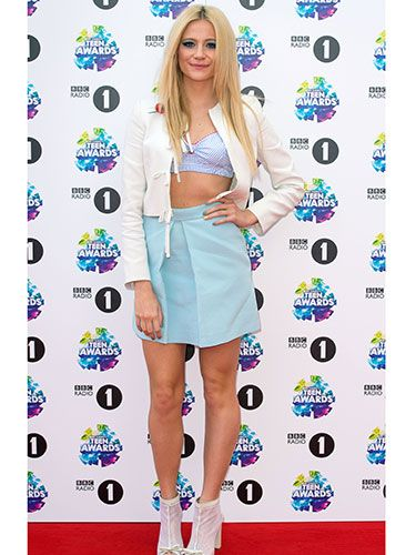 "<p>Pixie showed off her toned tum in a cropped top, blue skirt, and white leather jacket over top. Sweet, yet sexy.</p> <p><a href=""http://www.cosmopolitan.co.uk/beauty-hair/news/trends/celebrity-beauty/celebrities-go-makeup-free"" target=""_blank"">CELEBRITIES WITHOUT MAKEUP</a></p> <p><a href=""http://www.cosmopolitan.co.uk/beauty-hair/news/trends/celebrity-beauty/best-celebrity-beauty-tips"" target=""_blank"">BEST CELEBRITY BEAUTY TIPS</a></p> <p><a href=""http://www.cosmopolitan.co.uk/beauty-hair/news/trends/celebrity-beauty/celebs-in-wigs"" target=""_blank"">CELEBRITIES IN WIGS</a></p>"