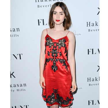 "<p>Lily Collins worked the 'underwear-as-outerwear' look at a magazine launch party. Wearing a red-and-black silk-and-lace dress (slash <span class=""st"">négligée</span>), the Hollywood star looked like a right little saucepot - and we're LOVING the bold lip.</p>