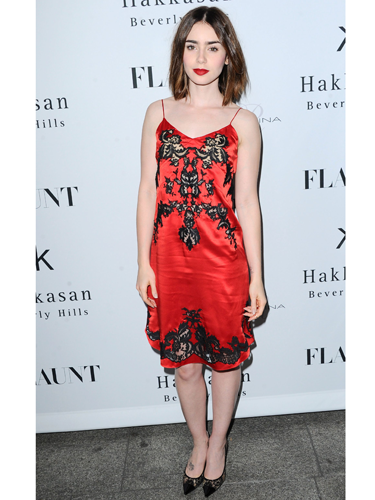 "<p>Lily Collins worked the 'underwear-as-outerwear' look at a magazine launch party. Wearing a red-and-black silk-and-lace dress (slash <span class=""st"">négligée</span>), the Hollywood star looked like a right little saucepot - and we're LOVING the bold lip.</p> <p><a href=""http://www.cosmopolitan.co.uk/fashion/love/"" target=""_blank"">VOTE ON CELEBRITY STYLE</a></p> <p><a href=""http://www.cosmopolitan.co.uk/fashion/shopping/womens-clothing-under-ten-pounds"" target=""_blank"">SHOP WOMEN'S FASHION FOR £10 OR LESS</a></p> <p><a href=""http://www.cosmopolitan.co.uk/fashion/celebrity/"" target=""_blank"">SEE THE LATEST CELEBRITY TRENDS</a></p>"