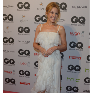 <p>Kylie Minogue was honoured with the 'Gentlewoman of the Year' award at the GQ Men of the Year Awards, which she accepted wearing a beautiful white Nina Ricci frothy flamenco-style gown. Didn't she look darling?</p>