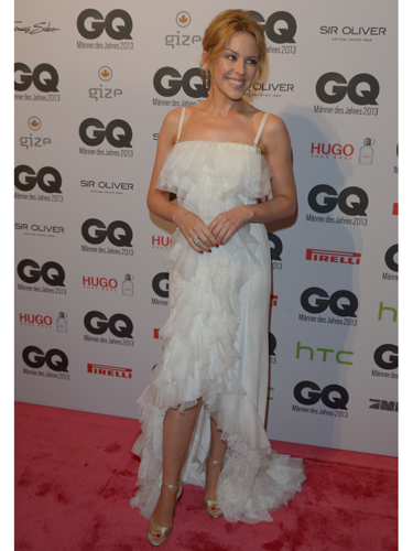 "<p>Kylie Minogue was honoured with the 'Gentlewoman of the Year' award at the GQ Men of the Year Awards, which she accepted wearing a beautiful white Nina Ricci frothy flamenco-style gown. Didn't she look darling?</p> <p><a href=""http://www.cosmopolitan.co.uk/fashion/love/"" target=""_blank"">VOTE ON CELEBRITY STYLE</a></p> <p><a href=""http://www.cosmopolitan.co.uk/fashion/shopping/womens-clothing-under-ten-pounds"" target=""_blank"">SHOP WOMEN'S FASHION FOR £10 OR LESS</a></p> <p><a href=""http://www.cosmopolitan.co.uk/fashion/celebrity/"" target=""_blank"">SEE THE LATEST CELEBRITY TRENDS</a></p>"