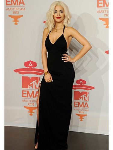 """<p>Rita looked anything but basic in a stunning Calvin Klein black gown with a thigh-high slit. And that bombshell beauty hair? We're obsessed.</p> <p><a href=""""http://www.cosmopolitan.co.uk/fashion/celebrity/best-dressed-celebrities-08-november"""" target=""""_blank"""">SEE: THIS WEEK'S BEST DRESSED CELEBS</a></p> <p><a href=""""http://www.cosmopolitan.co.uk/fashion/shopping/celebrity-winter-coat-inspiration"""" target=""""_blank"""">WINTER COAT INSPIRATION FROM CELEBRITIES</a></p> <p><a href=""""http://www.cosmopolitan.co.uk/beauty-hair/news/trends/celebrity-beauty/celebrity-beauty-looks-2013-mtv-emas"""" target=""""_blank"""">THE BEST BEAUTIES AT THE MTV EMAs 2013</a></p> <p> </p>"""