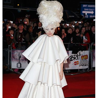 <p>In a surprising demure dress, yet still sky-high hair, Lady Gaga made an appearance at the 2011 Brit Awards in Earl's Court. We can't help but wonder&#x3B; how did she keep her head up?</p>