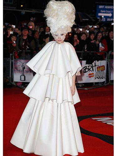 "<p>In a surprising demure dress, yet still sky-high hair, Lady Gaga made an appearance at the 2011 Brit Awards in Earl's Court. We can't help but wonder; how did she keep her head up?</p> <p><a href=""http://www.cosmopolitan.co.uk/celebs/entertainment/lady-gaga-marijuana-addiction"" target=""_blank"">LADY GAGA TALKS ADDICTION</a></p> <p><a href=""http://www.cosmopolitan.co.uk/celebs/entertainment/lady-gaga-naked-gay-nightclub?click=main_sr"" target=""_blank"">LADY GAGA GETS COMPLETELY NAKED AT G-A-Y NIGHTCLUB</a></p> <p><a href=""http://www.cosmopolitan.co.uk/celebs/celebrity-gossip/lady-gaga-neck-tattoo-rio?click=main_sr"" target=""_blank"">GAGA SHOWS OFF BRAND NEW NECK TATTOO</a></p>"