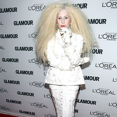 <p>For her appearance at this year's Glamour Women of the Year Awards in New York, Lady Gaga showed up in head-to-toe white. And yes, of course, that includes eyebrows, eyelashes, and hairline.</p>