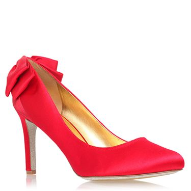 """<p>They're not quite ruby slippers, but we can guarantee owning these scarlet wonders would transport us to a happy place. The pretty bows at the back are the perfect festive finishing touch. Santa baby, please read this! </p><p>Red High Heel Court Shoes, £125, <a href=""""http://www.kurtgeiger.com/women/shoes/givemelux2-red-satin-42-nine-west-shoe.html"""" target=""""_blank"""">kurtgeiger.com</a></p><p><a href=""""http://www.cosmopolitan.co.uk/fashion/shopping/christmas-party-accessories-jewellery-bags"""" target=""""_blank"""">OUR FAVOURITE PARTY ACCESSORIES</a></p><p><a href=""""http://www.cosmopolitan.co.uk/fashion/shopping/cheap-christmas-party-dresses"""" target=""""_blank"""">PARTY DRESSES FOR UNDER £25</a></p><p><a href=""""http://www.cosmopolitan.co.uk/fashion/shopping/womens-christmas-fair-isle-jumpers-2013"""" target=""""_blank"""">NINE NIFTY KNITS</a></p>"""
