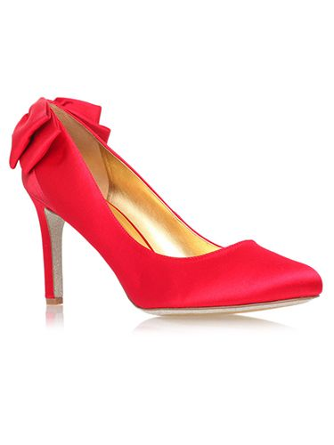 <p>They're not quite ruby slippers, but we can guarantee owning these scarlet wonders would transport us to a happy place. The pretty bows at the back are the perfect festive finishing touch. Santa baby, please read this! </p>
