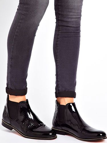 <p>Black ankle boots, be they heeled or flat, are timeless and work with almost every outfit. Winter calls for such shoes, and the Chelsea boot is undeniably versatile. These flat patent black Chelsea boots by British label H by Hudson, exclusive to ASOS, are practical, comfortable and tres fashionable.</p>