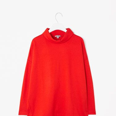 """<p>The Cosmo web team are all over the polo necks this season (see our <a href=""""http://www.cosmopolitan.co.uk/fashion/how-to-wear-polo-necks"""" target=""""_blank"""">guide on how to wear them!</a>) - we're loving this wide roll-neck from Cos, especially in this festive red hue. Its oversized fit makes it the perfect throw-over-jeans top, and will winter-fy any outfit.</p><p>Wide roll-neck top, £55, <a href=""""http://www.cosstores.com/Shop/Women/Tops/Tops/Wide_roll-neck_top/10673109-3301796.1#c-85344"""" target=""""_blank"""">Cos</a></p><p><a href=""""http://www.cosmopolitan.co.uk/fashion/shopping/new-in-store-11-november"""" target=""""_blank"""">NEW IN STORE THIS WEEK</a></p><p><a href=""""http://www.cosmopolitan.co.uk/fashion/shopping/celebrity-winter-coat-inspiration"""" target=""""_blank"""">WINTER COAT INSPIRATION</a></p><p><a href=""""http://www.cosmopolitan.co.uk/fashion/shopping/christmas-party-dresses-investment"""" target=""""_blank"""">TEN INVESTMENT PARTY DRESSES </a></p>"""