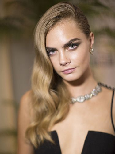 "<p><strong>The inspiration:</strong> Cara Delevingne</p> <p><strong>The look:</strong> Don't fancy getting your head shaved to achieve the undercut effect? Well you don't have to – simply sculpt one side of the hair tightly to your head, and let the loose waves tumble over one shoulder.</p> <p><strong>Key product:</strong> After creating waves using rollers or tongs, brush them out to soften. Then, using a paddle brush, tightly scrape back the hair on one side of the head, securing with kirby grips and a <a href=""http://www.superdrug.com/elnett/elnett-satin-hairspray-supreme-hold-200ml/invt/549312?source=179_75"" target=""_blank"">strong-hold hairspray</a>. For more information on how to create side-swept waves, <a href=""http://www.cosmopolitan.co.uk/video/?click=vid_sr&click=vid_sr#v2189783936001"" target=""_blank"">watch the video here.</a></p> <p>Elnett Satin Hairspray Supreme Hold, £3.89, <a href=""http://www.superdrug.com/elnett/elnett-satin-hairspray-supreme-hold-200ml/invt/549312?source=179_75"" target=""_blank"">superdrug.com</a></p> <p><a href=""http://www.cosmopolitan.co.uk/beauty-hair/news/styles/celebrity/celebrity-bob-hairstyles"" target=""_blank"">20 CELEBRITY BOB CUTS WE LOVE</a></p> <p><a href=""http://www.cosmopolitan.co.uk/beauty-hair/news/styles/celebrity/face-framing-fringes-hair-trend?click=main_sr"" target=""_blank"">COOL CELEBRITY FRINGES</a></p> <p><a href=""http://www.cosmopolitan.co.uk/beauty-hair/news/styles/celebrity/autumn-hair-trends"" target=""_blank"">NEW CELEB HAIR TRENDS TO TRY NOW</a></p>"