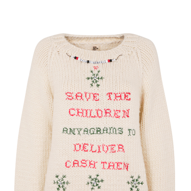 """<p>Say it with a Christmas jumper, courtesy of Anya Hindmarch's cross-stitch design.</p><p><em class=""""i"""">Find out how to bid on this designer Christmas jumper (lowest unique bid wins!) at</em> <em><a href=""""http://www.christmasjumperday.org/designerchristmasjumpers"""" target=""""_blank"""">christmasjumperday.org/designerchristmasjumpers</a>.</em></p><p><a href=""""http://www.cosmopolitan.co.uk/fashion/shopping/christmas-jumpers-2013-primark-womens"""" target=""""_blank"""">PRIMARK'S CHRISTMAS JUMPERS ARE AMAZING<em><br /></em></a></p><p><a href=""""http://www.cosmopolitan.co.uk/fashion/shopping/womens-christmas-fair-isle-jumpers-2013"""" target=""""_blank"""">FAIR ISLE FASHION: NIFTY KNITS TO KEEP YOU COSY</a></p><p><a href=""""http://www.cosmopolitan.co.uk/fashion/news/"""" target=""""_blank"""">GET THE LATEST FASHION AND STYLE NEWS</a></p>"""