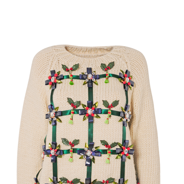 """<p>Mary Katranzou has decked her jumper with boughs of holly.</p><p><em class=""""i"""">Find out how to bid on this designer Christmas jumper (lowest unique bid wins!) at</em> <em><a href=""""http://www.christmasjumperday.org/designerchristmasjumpers"""" target=""""_blank"""">christmasjumperday.org/designerchristmasjumpers</a>.</em></p><p><a href=""""http://www.cosmopolitan.co.uk/fashion/shopping/christmas-jumpers-2013-primark-womens"""" target=""""_blank"""">PRIMARK'S CHRISTMAS JUMPERS ARE AMAZING<em></em></a></p><p><a href=""""http://www.cosmopolitan.co.uk/fashion/shopping/womens-christmas-fair-isle-jumpers-2013"""" target=""""_blank"""">FAIR ISLE FASHION: NIFTY KNITS TO KEEP YOU COSY</a></p><p><a href=""""http://www.cosmopolitan.co.uk/fashion/news/"""" target=""""_blank"""">GET THE LATEST FASHION AND STYLE NEWS</a><em><br /></em></p>"""