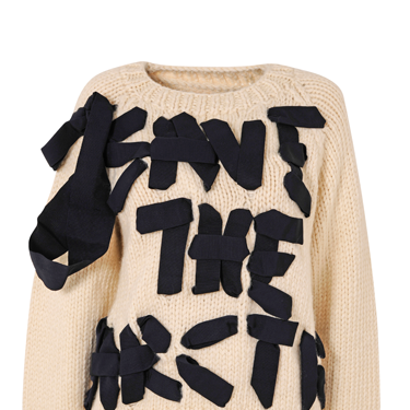 """<p>A serious message, delivered in bows. We'd expect no less from our Viv.</p><p><em class=""""i"""">Find out how to bid on this designer Christmas jumper (lowest unique bid wins!) at</em> <em><a href=""""http://www.christmasjumperday.org/designerchristmasjumpers"""" target=""""_blank"""">christmasjumperday.org/designerchristmasjumpers</a>.</em></p><p><a href=""""http://www.cosmopolitan.co.uk/fashion/shopping/christmas-jumpers-2013-primark-womens"""" target=""""_blank"""">PRIMARK'S CHRISTMAS JUMPERS ARE AMAZING<em></em></a></p><p><a href=""""http://www.cosmopolitan.co.uk/fashion/shopping/womens-christmas-fair-isle-jumpers-2013"""" target=""""_blank"""">FAIR ISLE FASHION: NIFTY KNITS TO KEEP YOU COSY</a></p><p><a href=""""http://www.cosmopolitan.co.uk/fashion/news/"""" target=""""_blank"""">GET THE LATEST FASHION AND STYLE NEWS</a><em><br /></em></p>"""