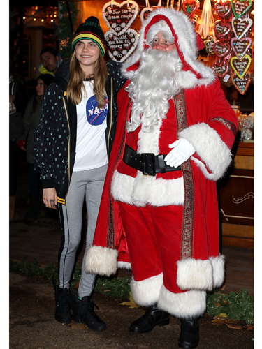 "<p>Step aside Rita, Cara's got a new wifey, or should we say hubby, in the form of this festive fella - the one, the only, Santa Claus! We love seeing Cara getting into the Crizza spirit, don't you?</p> <p><a href=""http://www.cosmopolitan.co.uk/fashion/shopping/celebrity-winter-coat-inspiration"" target=""_blank"">GET WINTER COAT INSPIRATION FROM THE CELEBS</a></p> <p><a href=""http://www.cosmopolitan.co.uk/fashion/shopping/top-five-beanie-hats-for-women"" target=""_blank"">SHOP 5 HOT BEANIE HATS LIKE CARA'S</a></p> <p><a href=""http://www.cosmopolitan.co.uk/fashion/shopping/"" target=""_blank"">SEE: WHAT TO BUY RIGHT NOW</a></p>"