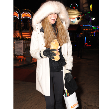 <p>Looking a bit like Brian Harvey in an E17 Christmas video, Elle models this season's must-have accessory: the tiny cuddly bear.</p>