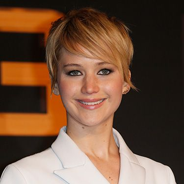 """<p>In Germany, Jen opted for a sideswept style, while she kept the rest of her hair smooth with just a bit of texture in her tendrils. A great everyday look.</p><p><a href=""""http://www.cosmopolitan.co.uk/fashion/celebrity/winter-wonderland-2013-celebrity-style"""" target=""""_blank"""">CELEBRITIES AT WINTER WONDERLAND</a></p><p><a href=""""http://www.cosmopolitan.co.uk/fashion/celebrity/best-dressed-celebrities-08-november"""" target=""""_blank"""">BEST DRESSED CELEBS OF THE WEEK</a></p><p><a href=""""http://www.cosmopolitan.co.uk/beauty-hair/news/beauty-news/jennifer-lawrence-new-miss-dior-campaign-shots?click=main_sr"""" target=""""_blank"""">JEN LAWRENCE IS A BARE-FACED BEAUTY IN NEW DIOR CAMPAIGN</a></p>"""