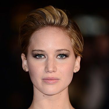 """<p>For the London Catching Fire premiere, J Law went for a deep part on her left side - and pumped up the volume, combing over and teasing the rest of her tresses.</p><p><a href=""""http://www.cosmopolitan.co.uk/fashion/celebrity/winter-wonderland-2013-celebrity-style"""" target=""""_blank"""">CELEBRITIES AT WINTER WONDERLAND</a></p><p><a href=""""http://www.cosmopolitan.co.uk/fashion/celebrity/best-dressed-celebrities-08-november"""" target=""""_blank"""">BEST DRESSED CELEBS OF THE WEEK</a></p><p><a href=""""http://www.cosmopolitan.co.uk/beauty-hair/news/beauty-news/jennifer-lawrence-new-miss-dior-campaign-shots?click=main_sr"""" target=""""_blank"""">JEN LAWRENCE IS A BARE-FACED BEAUTY IN NEW DIOR CAMPAIGN</a></p>"""