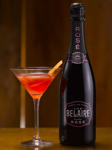 """<p>An aromatic, provocative cocktail with the perfect balance of bitter orange and tart raspberry complemented by the sweet red and dark fruits in <a href=""""http://www.belairerose.com/"""" target=""""_blank"""">Belaire Rosé</a>.<br /><br /><strong>Ingredients:</strong><br />70mL Belaire Rosé<br />5mL Mandarine Napoleon<br />5mL Chambord<br />10mL Vanilla Flavoured Vodka<br />Orange / Lime Oil<br />Candied Orange Peel To Garnish<br />Served In A Martini Glass<br /><br /><strong>Method:</strong><br />Combine all of the ingredients except Belaire Rosé into a cocktail<br />shaker on ice and shake. Pour Belaire Rosé into the well shaken ingredients and stir gently. Strain into a chilled martini glass and spray orange or lime oil on the top of the liquid. Garnish with a peel of candied orange.</p>"""