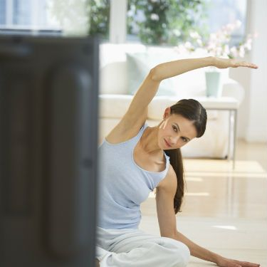"""<p><strong><em>John Williams, David Lloyd Leisure's expertise coach, says...</em></strong></p><p>""""Rather than slouching on the couch, get down on the floor and have a thorough stretch while watching your favourite shows. This will not only improve your flexibility but will go some way to lift your energy levels.""""</p>"""