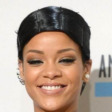 <p>Obviously Rihanna went for a stand-out style, doing an exaggerated comb-over held down with pins. The jury's out.</p>