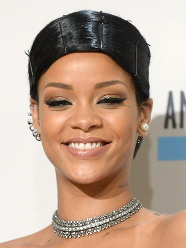 """<p>Obviously Rihanna went for a stand-out style, doing an exaggerated comb-over held down with pins. The jury's out.</p><p><a href=""""http://www.cosmopolitan.co.uk/beauty-hair/news/styles/celebrity/celebrity-party-hair-style-inspiration"""" target=""""_blank"""">PARTY HAIRSTYLE IDEAS</a></p><p><a href=""""http://www.cosmopolitan.co.uk/beauty-hair/news/trends/celebrity-beauty/pixie-crop-celebrity-icons"""" target=""""_blank"""">CELEBRITY TREND: SHORT HAIR</a></p><p><a href=""""http://www.cosmopolitan.co.uk/beauty-hair/news/styles/celebrity/face-framing-fringes-hair-trend?click=main_sr"""" target=""""_blank"""">COOL CELEBRITY FRINGES</a></p>"""