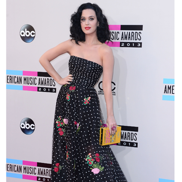 """<p>KPez pulled out all the stops and totally rocked her floral and polka dot Oscar de la Renta frock, before opening the AMAs dressed as a Geisha. Check out also her <span class=""""st"""">quirky Olympia Le-Tan dictionary clutch</span>.</p><p><a href=""""http://www.cosmopolitan.co.uk/fashion/news/miley-cyrus-amas-2013-outfits"""" target=""""_blank"""">MILEY CYRUS WINS THE INTERNET AT THE AMAs</a></p><p><a href=""""http://www.cosmopolitan.co.uk/beauty-hair/news/styles/celebrity/ama-2013-best-celebrity-hairstyles"""" target=""""_blank"""">SEE THE BEST CELEBRITY HAIR AT THE AMAs</a></p><p><a href=""""http://www.cosmopolitan.co.uk/fashion/celebrity/"""" target=""""_blank"""">GET THE LATEST CELEBRITY STYLE NEWS</a></p>"""