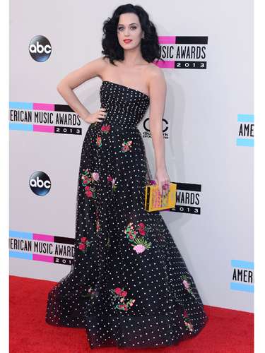 "<p>KPez pulled out all the stops and totally rocked her floral and polka dot Oscar de la Renta frock, before opening the AMAs dressed as a Geisha. Check out also her <span class=""st"">quirky Olympia Le-Tan dictionary clutch</span>.</p>