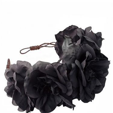 """<p class=""""p1"""">If bright florals feel a bit more festival than festive, try this incredible black rose crown which will update your staple party outfit. Plus it doubles up as a bad hair day-hider. </p><p class=""""p2"""">Ophelia Oversized Floral Crown Headband, <span class=""""s1"""">£42, <a href=""""%20http://www.rocknrose.co.uk/headwear-c6/crowns-c15/ophelia-oversized-floral-crown-headband-p484"""" target=""""_blank"""">rocknrose.co.uk</a></span></p><p class=""""p1""""><a href=""""http://www.cosmopolitan.co.uk/fashion/shopping/cheap-christmas-party-dresses"""" target=""""_blank"""">PARTY DRESSES FOR £25 OR LESS</a></p><p class=""""p1""""><a href=""""http://www.cosmopolitan.co.uk/fashion/shopping/christmas-party-accessories-jewellery-bags"""" target=""""_blank"""">PARTY JEWELLERY TO COVET</a></p><p class=""""p1""""><a href=""""http://www.cosmopolitan.co.uk/fashion/shopping/christmas-party-high-heel-shoes"""" target=""""_blank"""">THE BEST PARTY HIGH HEELS</a></p>"""