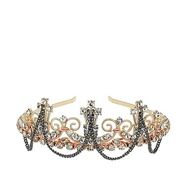 """<p class=""""p1"""">Thanks to Dolce & Gabbana's Winter 2013 catwalk, crowns are a huge trend and this little jewel is the Cosmo way to wear it. Well, who <em>doesn't</em> want to look like a princess?</p><p class=""""p2"""">Freedom at Topshop Gold Crown With Rhinestones, £25, <a href=""""http://www.topshop.com/en/tsuk/product/bags-accessories-1702216/hair-accessories-464/gold-crown-with-rhinestones-2390024?bi=1&ps=200"""" target=""""_blank"""">topshop.com</a></p><p class=""""p1""""><a href=""""http://www.cosmopolitan.co.uk/fashion/shopping/cheap-christmas-party-dresses"""" target=""""_blank"""">PARTY DRESSES FOR £25 OR LESS</a></p><p class=""""p1""""><a href=""""http://www.cosmopolitan.co.uk/fashion/shopping/christmas-party-accessories-jewellery-bags"""" target=""""_blank"""">PARTY JEWELLERY TO COVET</a></p><p class=""""p1""""><a href=""""http://www.cosmopolitan.co.uk/fashion/shopping/christmas-party-high-heel-shoes"""" target=""""_blank"""">THE BEST PARTY HIGH HEELS</a></p>"""