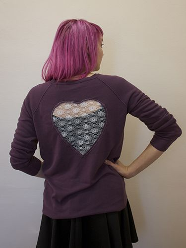 "<p>You don't always have to wear your heart on your sleeve; with this guide you can stitch it on the back of an old jumper.</p> <p><strong>You Will Need:</strong> Jumper, One sizeable Quarter (1/4yd) of Lace, Fabric Large Piece of Paper or Pattern Paper, Pencil, Paper, Scissors, Tailor's Chalk, Fabric Scissors, Pins, Sewing Machine</p> <p>1. Fold the paper in half, and draw half of a heart along the fold. This heart can be as large as you like. Cut out the heart, then you have your template.</p> <p>2. Place the heart template onto the back of the jumper to settle on where you'd like the heart cut-out to be, and pin into place.</p> <p>3. Draw around the template with chalk.</p> <p>4. Cut out the inside of the heart.</p> <p>5. Fold the paper template in half, and pin this to the lace fabric on the fold, lining up the edges.</p> <p>6. Cut out a heart shape in the lace fabric, ensuring you add a 1.5cm seam allowance around the template</p> <p>7. Turn the jumper inside out, lay the lace over the cut-out and pin into place.</p> <p>8. Use a small zigzag stitch on your sewing machine to sew the lace heart to the jumper.</p> <p><a href=""http://www.cosmopolitan.co.uk/fashion/shopping/christmas-jumpers?click=main_sr"" target=""_blank"">NEW LOOK'S CHRISTMAS JUMPERS ARE IN</a></p> <p><a href=""http://www.cosmopolitan.co.uk/fashion/news/fearne-cotton-picture-perfect-autumn-jumper?click=main_sr"" target=""_blank"">FEARNE COTTON ROCKS OVERSIZED JUMPER</a></p> <p><a href=""http://www.cosmopolitan.co.uk/blogs/cosmo-blog-awards-2013/best-craft-blog-2013-blogger-hot-topics?click=main_sr"" target=""_blank"">BEST CRAFT BLOG HOT TOPICS</a></p>"