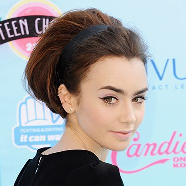 """<p><strong>The inspiration:</strong> Lily Collins</p><p><strong>The look:</strong> Foxy flicks have been the look du jour since the days of Cleopatra (or at least the Elizabeth Taylor version). Use a liquid eyeliner to keep them ultra-defined, and keep a face wipe handy for any corrections!</p><p><strong>Key product:</strong> Rimmel Exaggerate Eye Liner, £5.29, <a href=""""http://www.boots.com/en/Rimmel-Exaggerate-Eye-Liner_6935/"""" target=""""_blank"""">Boots.com</a></p><p><a href=""""http://www.cosmopolitan.co.uk/beauty-hair/beauty-tips/how-to-wear-bright-makeup"""" target=""""_blank"""">HOW TO WEAR BRIGHT MAKEUP</a></p><p><a href=""""http://www.cosmopolitan.co.uk/beauty-hair/news/styles/celebrity/celebrity-party-hair-style-inspiration?click=main_sr"""" target=""""_blank"""">CELEBRITY PARTY HAIR IDEAS</a></p><p><a href=""""http://www.cosmopolitan.co.uk/fashion/shopping/christmas-party-dresses-investment"""" target=""""_blank"""">10 DREAMY PARTY DRESSES</a></p>"""