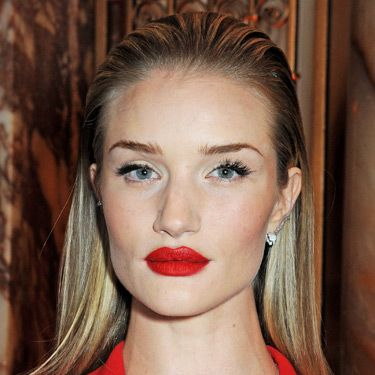 """<p>Rosie made a fierce fashion statement at the BFAs, pairing an arresting red pout with brushed-up brows and slick-back, wet-look hair. We wouldn't mess.</p><p><a href=""""http://www.cosmopolitan.co.uk/beauty-hair/news/styles/celebrity/cosmo-hairstyle-of-the-day"""" target=""""_self"""">COSMO'S CELEB HAIRSTYLE OF THE DAY</a></p><p><a href=""""http://www.cosmopolitan.co.uk/beauty-hair/news/styles/celebrity/how-to-do-kelly-brook-blow-dry"""" target=""""_blank"""">GET KELLY BROOK'S PARTY BLOW-DRY</a></p><p><a href=""""http://www.cosmopolitan.co.uk/beauty-hair/news/styles/celebrity/jennifer-lawrence-best-hair-moments?page=1"""" target=""""_blank"""">JENNIFER LAWRENCE'S 9 PIXIE CROP STYLES</a></p>"""