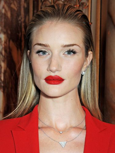 """<p>Rosie made a fierce fashion statement at the BFAs, pairing an arresting red pout with brushed-up brows and slick-back, wet-look hair. We wouldn't mess.</p> <p><a href=""""http://www.cosmopolitan.co.uk/beauty-hair/news/styles/celebrity/cosmo-hairstyle-of-the-day"""" target=""""_self"""">COSMO'S CELEB HAIRSTYLE OF THE DAY</a></p> <p><a href=""""http://www.cosmopolitan.co.uk/beauty-hair/news/styles/celebrity/how-to-do-kelly-brook-blow-dry"""" target=""""_blank"""">GET KELLY BROOK'S PARTY BLOW-DRY</a></p> <p><a href=""""http://www.cosmopolitan.co.uk/beauty-hair/news/styles/celebrity/jennifer-lawrence-best-hair-moments?page=1"""" target=""""_blank"""">JENNIFER LAWRENCE'S 9 PIXIE CROP STYLES</a></p>"""