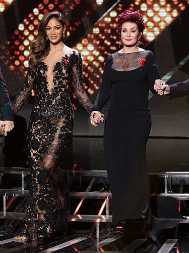 "<p><span>We're definitely seeing a theme here - a black, lacy, sheer theme to be specific. Hardly surprising, given that both ladies love a bit of drama.</span></p> <p><span>Nicole Scherzinger's intricate dress looks shamazing, showing off her awesome figure, while Sharon looked striking in a gothic gown. Bravo ladies!</span></p> <p><a href=""http://www.cosmopolitan.co.uk/fashion/celebrity/how-to-wear-sheer-dress"" target=""_blank""><span>CELEBS IN SHEER DRESSES</span></a></p> <p><a href=""http://www.cosmopolitan.co.uk/fashion/shopping/primark-christmas-party-jewellery-2013"" target=""_blank""><span>PRIMARK'S NEW PARTY JEWELS</span></a></p> <p><a href=""http://www.cosmopolitan.co.uk/fashion/shopping/womens-clothing-under-ten-pounds"" target=""_blank""><span>FASHION BUYS FOR UNDER A TENNER</span></a></p>"