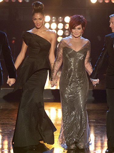 "<p>For Saturday night's show, Sharon opted for a sheer-sleeved, metallic grey dress with a deep V at the front.</p> <p>Nicole, meanwhile, wore her hair up in a giant topknot and an asymmetric black dress featuring origami style folds.</p> <p>It's nice to see them both change things up, although we're not sure it's either of their best looks!</p> <p><a href=""http://www.cosmopolitan.co.uk/fashion/shopping/christmas-party-dress-2013-alternatives"" target=""_blank"">PARTY WEAR BEYOND THE LBD</a></p> <p><a href=""http://www.cosmopolitan.co.uk/fashion/shopping/cheap-christmas-party-dresses"" target=""_blank"">SHOP PARTY DRESSES FOR £25 OR LESS</a></p> <p><a href=""http://www.cosmopolitan.co.uk/fashion/shopping/christmas-party-best-flat-shoes"" target=""_blank"">FABULOUS PARTY FLAT SHOES</a></p>"