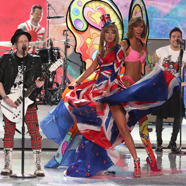 """<p>Oh, it's ALL going on here: T-Swizzle in all her Union Jack finery on stage with Fall Out Boy AND Karlie Kloss looking as impressed as we were at Swifty's 'swooshing' skills.</p><p><a href=""""http://www.cosmopolitan.co.uk/fashion/celebrity/best-dressed-victorias-secret-fashion-show"""" target=""""_blank"""">Best dressed at the Victoria's Secret Fashion Show </a></p><p><a href=""""http://www.cosmopolitan.co.uk/fashion/news/cara-delevingne-victorias-secret-show-model"""" target=""""_blank"""">Cara Delevingne: From gurner to sexy Victoria's Secret model </a></p><p><a href=""""http://www.cosmopolitan.co.uk/fashion/news/"""" target=""""_blank"""">See the latest fashion and style news</a></p>"""