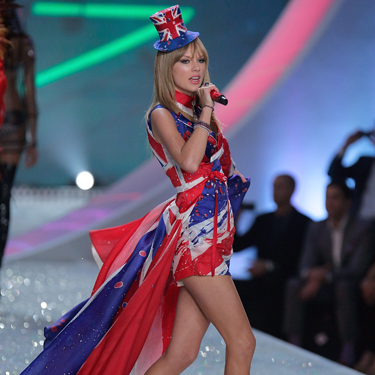 """<p>Taylor Swift reworks Geri Halliwell's Union Jack dress for 2013, complete with matching shoe boots and a tiny little top hat, worn at a jaunty angle.</p><p><a href=""""http://www.cosmopolitan.co.uk/fashion/celebrity/best-dressed-victorias-secret-fashion-show"""" target=""""_blank"""">Best dressed at the Victoria's Secret Fashion Show </a></p><p><a href=""""http://www.cosmopolitan.co.uk/fashion/news/cara-delevingne-victorias-secret-show-model"""" target=""""_blank"""">Cara Delevingne: From gurner to sexy Victoria's Secret model </a></p><p><a href=""""http://www.cosmopolitan.co.uk/fashion/news/"""" target=""""_blank"""">See the latest fashion and style news</a></p>"""
