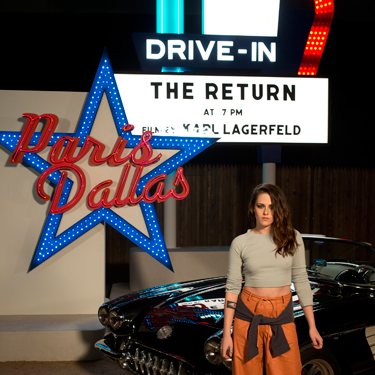 """<p>Kristen may well look a bit smug standing in front of a Chanel chevy (no idea if that's the correct car model, but sounds suitably Western...) and that's because she's the official <a href=""""http://www.cosmopolitan.co.uk/fashion/news/kristen-stewart-face-of-chanel"""" target=""""_blank"""">new face of Chanel</a>. Fancy.</p><p><a href=""""http://www.cosmopolitan.co.uk/fashion/shopping/best-bags-summer-fashion-2014"""" target=""""_blank"""">10 best bags from London Fashion Week summer 2014 </a></p><p><a href=""""http://www.cosmopolitan.co.uk/fashion/celebrity/celebrities-chanel-paris-fashion-week"""" target=""""_blank"""">Celebrity show-goers at Chanel Paris Fashion Week</a></p><p><a href=""""http://www.cosmopolitan.co.uk/fashion/news/"""" target=""""_blank"""">See the latest fashion and style news</a></p>"""