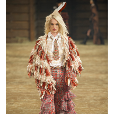 """<p>We can definitely see ourselves wearing this tweedy fringed ensemble when doing the weekly shop in Tesco. You?</p><p><a href=""""http://www.cosmopolitan.co.uk/fashion/shopping/best-bags-summer-fashion-2014"""" target=""""_blank"""">10 best bags from London Fashion Week summer 2014 </a></p><p><a href=""""http://www.cosmopolitan.co.uk/fashion/celebrity/celebrities-chanel-paris-fashion-week"""" target=""""_blank"""">Celebrity show-goers at Chanel Paris Fashion Week</a></p><p><a href=""""http://www.cosmopolitan.co.uk/fashion/news/"""" target=""""_blank"""">See the latest fashion and style news</a></p><p> </p>"""