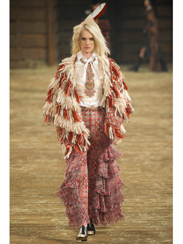 """<p>We can definitely see ourselves wearing this tweedy fringed ensemble when doing the weekly shop in Tesco. You?</p> <p><a href=""""http://www.cosmopolitan.co.uk/fashion/shopping/best-bags-summer-fashion-2014"""" target=""""_blank"""">10 best bags from London Fashion Week summer 2014 </a></p> <p><a href=""""http://www.cosmopolitan.co.uk/fashion/celebrity/celebrities-chanel-paris-fashion-week"""" target=""""_blank"""">Celebrity show-goers at Chanel Paris Fashion Week</a></p> <p><a href=""""http://www.cosmopolitan.co.uk/fashion/news/"""" target=""""_blank"""">See the latest fashion and style news</a></p> <p> </p>"""