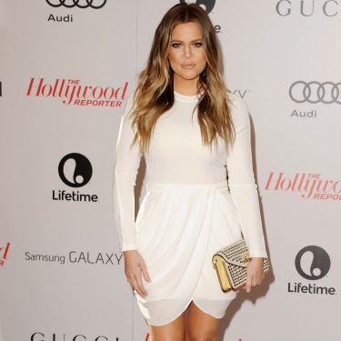 """<p>Khloe Kardashian looked kapow at the event, wearing all-white and accessorising with a studded gold clutch and NO wedding ring. Interesting...</p><p><a href=""""http://www.cosmopolitan.co.uk/fashion/celebrity/chanel-fashion-show-dallas-texas"""" target=""""_blank"""">CHANEL DOES DALLAS: SEE THE CELEB PICS</a></p><p><a href=""""http://www.cosmopolitan.co.uk/fashion/celebrity/victorias-secret-show-2013-taylor-swift"""" target=""""_blank"""">10 WAYS TAYLOR SWIFT TOTALLY OWNED THE VS SHOW</a></p><p><a href=""""http://www.cosmopolitan.co.uk/fashion/news/"""" target=""""_blank"""">GET THE LATEST FASHION AND STYLE NEWS</a></p>"""