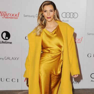 """<p>Oh hi there Kim! We nearly didn't notice you in your plain old outfit. We jest, of course. Kim looked quite the golden gal in her silky ensemble.</p><p><a href=""""http://www.cosmopolitan.co.uk/fashion/celebrity/chanel-fashion-show-dallas-texas"""" target=""""_blank"""">CHANEL DOES DALLAS: SEE THE CELEB PICS</a></p><p><a href=""""http://www.cosmopolitan.co.uk/fashion/celebrity/victorias-secret-show-2013-taylor-swift"""" target=""""_blank"""">10 WAYS TAYLOR SWIFT TOTALLY OWNED THE VS SHOW</a></p><p><a href=""""http://www.cosmopolitan.co.uk/fashion/news/"""" target=""""_blank"""">GET THE LATEST FASHION AND STYLE NEWS</a></p>"""