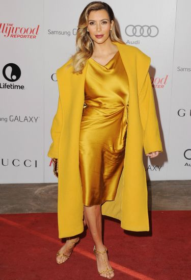 """<p>Oh hi there Kim! We nearly didn't notice you in your plain old outfit. We jest, of course. Kim looked quite the golden gal in her silky ensemble.</p> <p><a href=""""http://www.cosmopolitan.co.uk/fashion/celebrity/chanel-fashion-show-dallas-texas"""" target=""""_blank"""">CHANEL DOES DALLAS: SEE THE CELEB PICS</a></p> <p><a href=""""http://www.cosmopolitan.co.uk/fashion/celebrity/victorias-secret-show-2013-taylor-swift"""" target=""""_blank"""">10 WAYS TAYLOR SWIFT TOTALLY OWNED THE VS SHOW</a></p> <p><a href=""""http://www.cosmopolitan.co.uk/fashion/news/"""" target=""""_blank"""">GET THE LATEST FASHION AND STYLE NEWS</a></p>"""